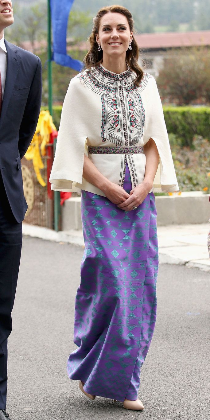 Катрин, Duchess of Cambridge walks with Prince William, Duke of Cambridge as part of a ceremonial Chipdrel on arrival into the Tashichhodzong (fortress) on the first day of a two day visit to Bhutan on the 14th April 2016 in Paro, Bhutan. The Royal cou