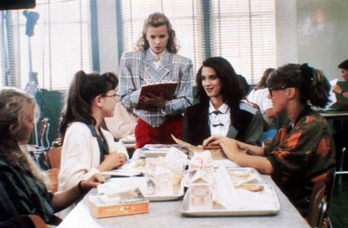 HEATHERS, Kim Walker (standing), Winona Ryder (seated facing front), 1988, © New World/courtesy Everett Collection