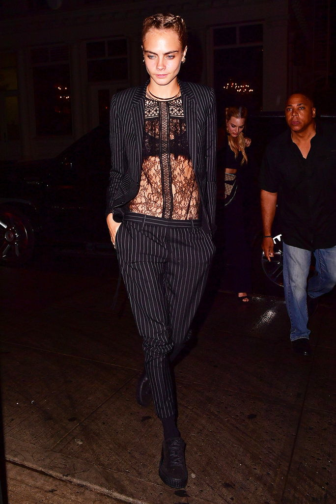 в a Zuhair Murad Lace Top and a Pinstriped Suit