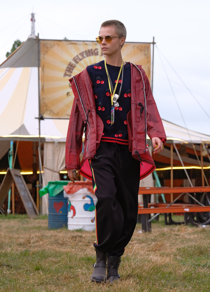 Кара going utiltarian on festival fashion in Hunter Originals coat and boots, 2017