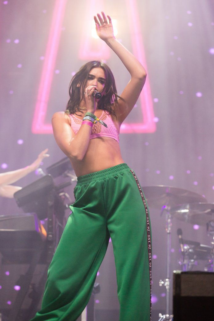Dua Lipa doing 'Lux Sporty Spice' onstage, 2017